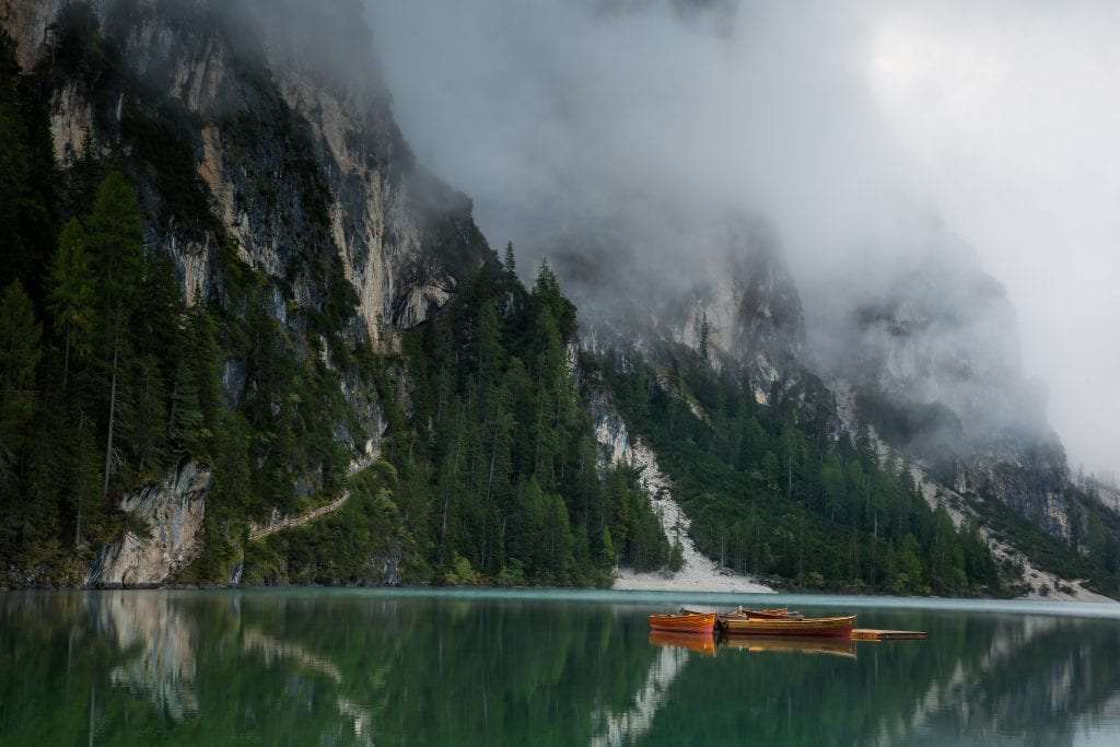 Braies lake with the fog over the water