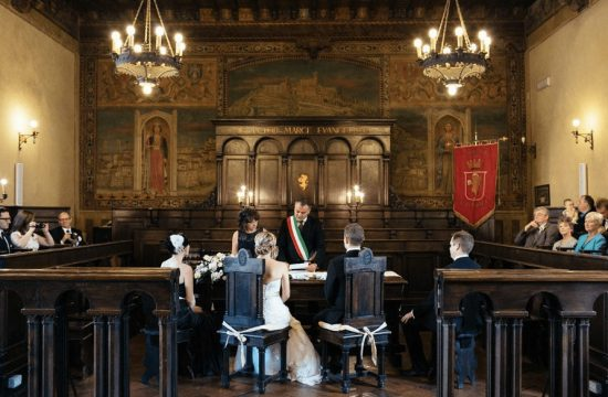 A legally binding ceremony in an Italian town hall.