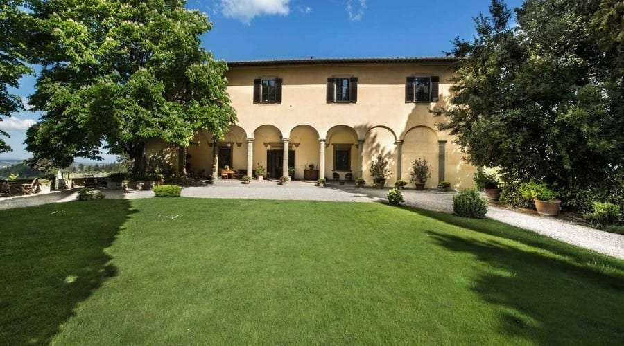 Lawn of a Tuscan Villa with colonnade