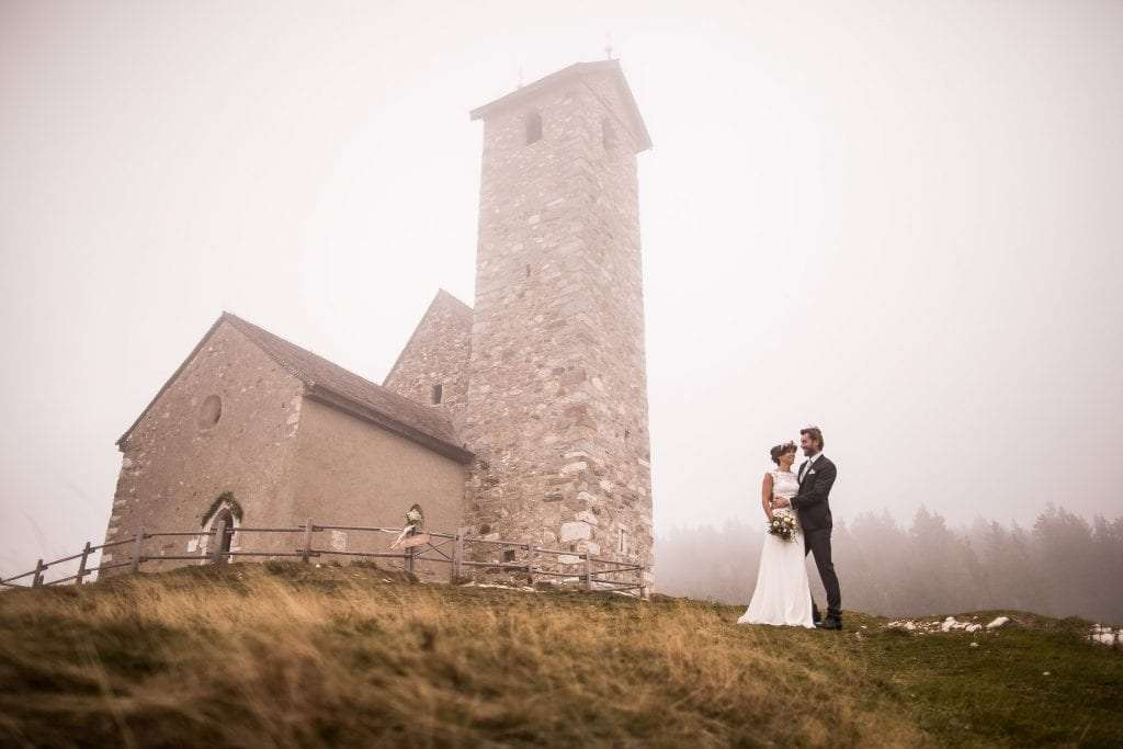 church up in the hill in South Tyrol during a catholic wedding