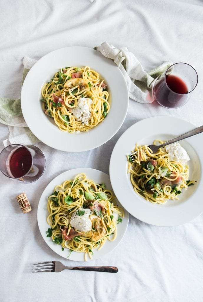 Three dishes of Spaghetti made with different recipes.