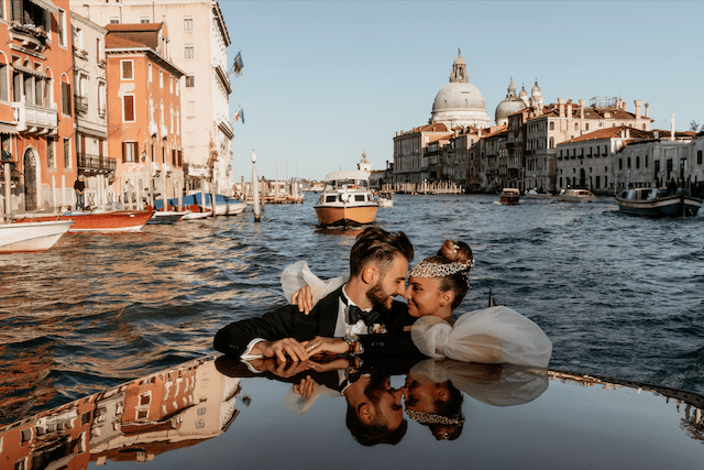 Newlywed couple on a taxi boat in Venice